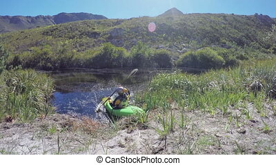Woman kayaking in lake at countryside 4k - Woman kayaking in...