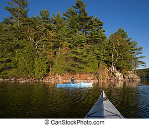 Woman Kayaking on Northern Lake