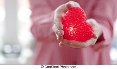 Woman keeping one's heart in her hands