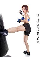 Woman Kick Boxer - Tough woman kickboxer practicing boxing...