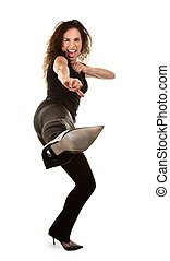 Woman kicking - Tough woman in high heels kicking at camera