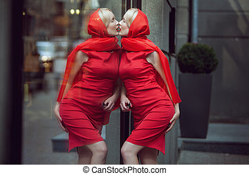Woman kisses her reflection. - Woman kisses her reflection...