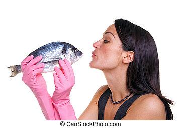 Woman kissing a fish