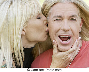 Woman kissing a man