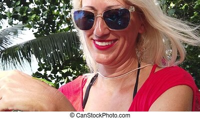 Woman kissing Gecko - SLOW MOTION: tourist woman playing...