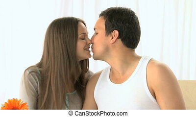 Woman kissing her boyfriend and dri
