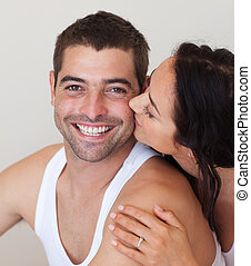 Woman kissing her Boyfriend - Young woman kissing her...