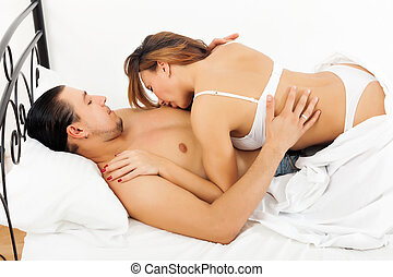 woman kissing her man in chest