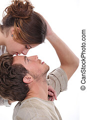 Woman kissing man on the forehead
