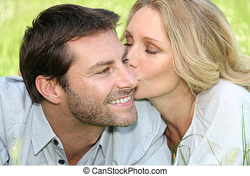 Woman kissing man