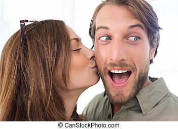 Woman kissing man with beard on the cheek - Pretty woman...