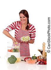 Woman kitchen vegetables