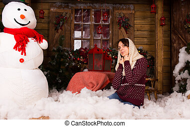 Woman Kneeling on Floor with Cottons Near Snow Man