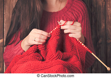 Woman knits sweater