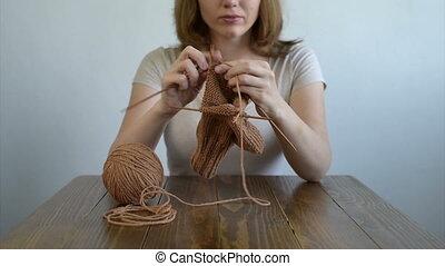 Woman knitting a sock