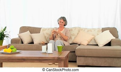 Woman knitting in the living room