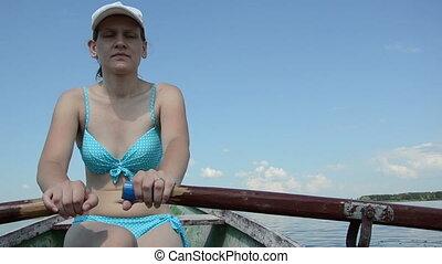 woman lake boat