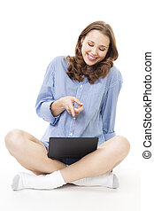 Woman laugh and point at laptop with finger