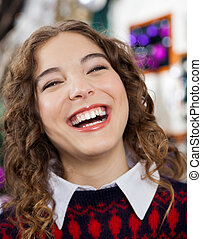 Woman Laughing In Christmas Store
