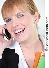 Woman laughing on her cellphone