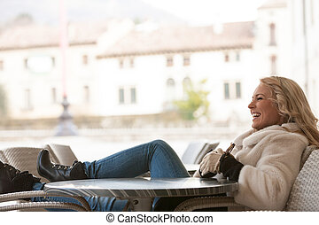 woman laughing outdoors in Europe