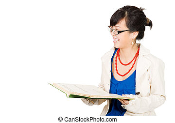 Woman laughing while reading