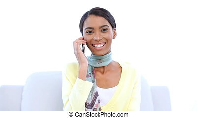 Woman laughing while she is on the phone