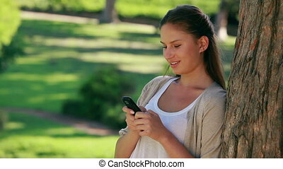 Woman laughing while texting
