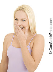 woman laughing with hand over mouth