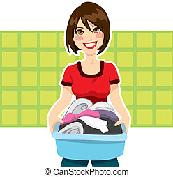 Woman Laundry Chores - Happy young woman holding clothes...