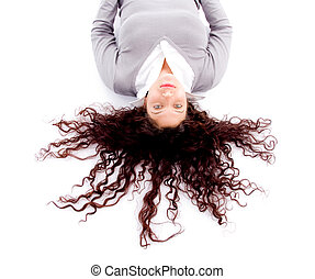 woman laying down on floor with hair spread out on white...