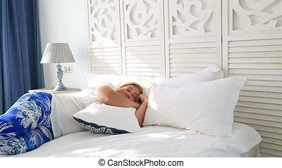 Woman laying on a bed and sleeping