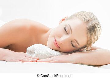 Woman laying on a mat in a beauty salon - Beautiful girl ...