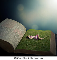 Woman laying on grass field in Bible