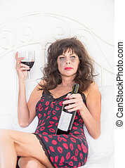 Woman Laying on her Bed and Drinking Wine