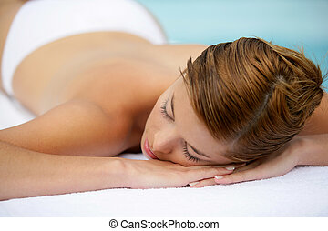 Woman laying on table waiting for massage