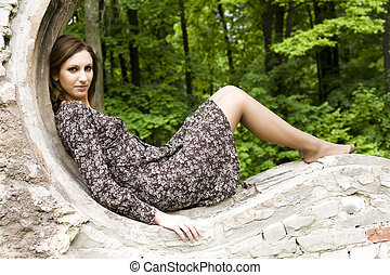 Woman Laying On The Brick Wall