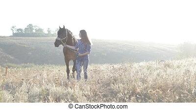 Woman lead horse walking field sunrise cowgirl countryside...