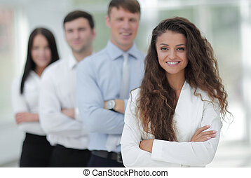 woman leader at the head of the business team