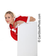 Woman leaning on a blank poster