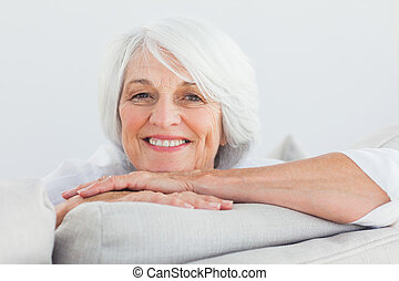 Woman leaning on a couch