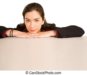 Woman Leaning on Desk While Looking at Camera
