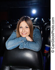 Woman Leaning On Seat At Cinema Theater