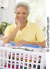 Woman Leaning On Washing Basket