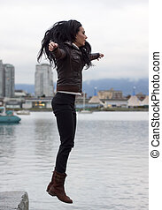 woman leaping off dockside edge