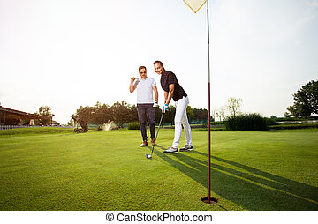 Woman learning how to play golf