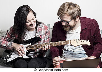 Woman learns to play the electronic guitar and she is ...