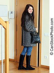 woman leaving  home