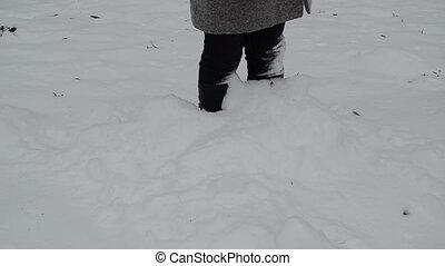 woman leg dig snow - woman legs standing in winter snowdrift...