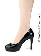 Woman leg in black shoe